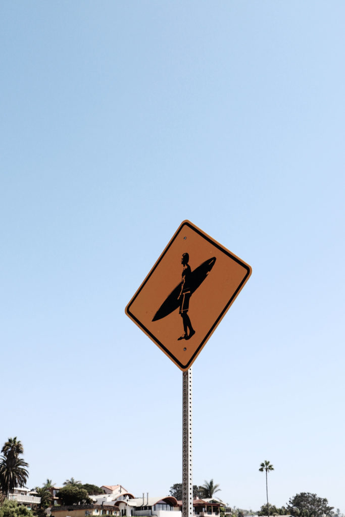 surfing crossing sign wave provocateur san diego california